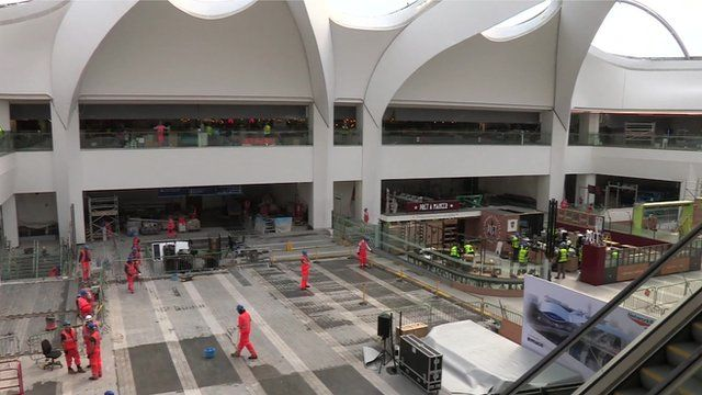 Workmen inside New Street station