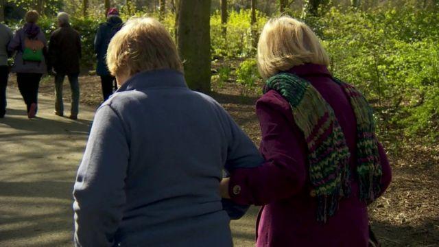 Elderly women walking in park