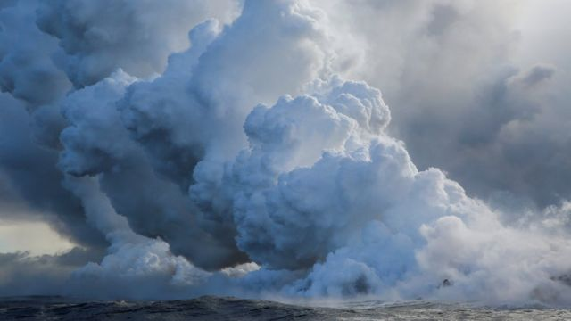 Lava flows into the Pacific Ocean south-east of Pahoa during ongoing eruptions of the Kilauea volcano, Hawaii