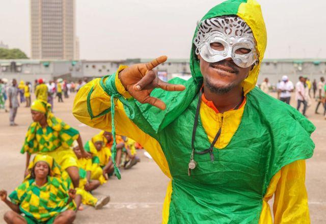 man dressed in carnival costume