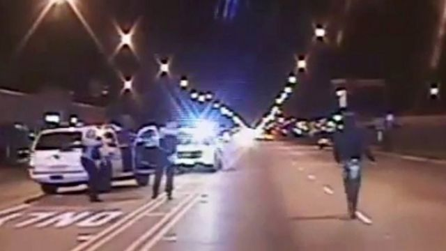 Laquan McDonald (R) walks on a road before he was shot 16 times by police officer Jason Van Dyke in Chicago, in this still image taken from a police vehicle dash camera video shot on October 20, 2014, and released by Chicago Police on November 24, 2015