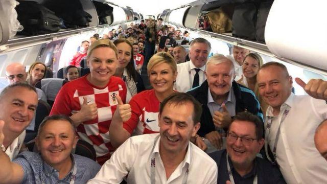 President Kolinda Grabar-Kitarovic and some fans inside plane