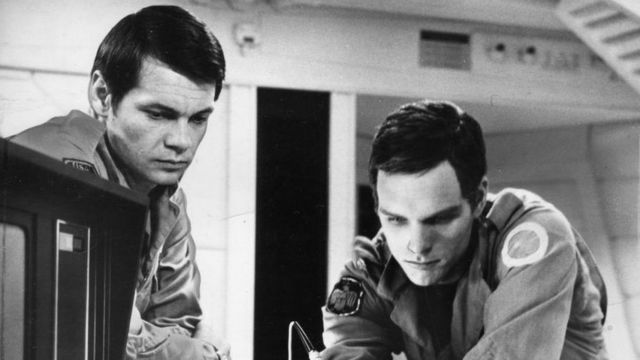 Actors Gary Lockwood (left) and Keir Dullea in a scene from '2001: A Space Odyssey', directed by Stanley Kubrick (1968)