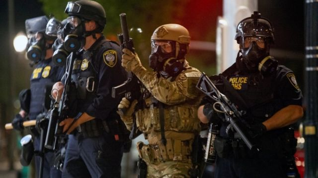 Federal officers face protesters in Oregon on 18 July