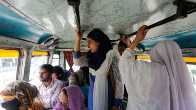 When Umaira Hassan travels in a regular bus, she has to stand even though a man occupies a seat reserved for ladies