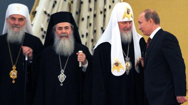 Putin con el líder de la Iglesia ortodoxa rusa, Kiril I.
