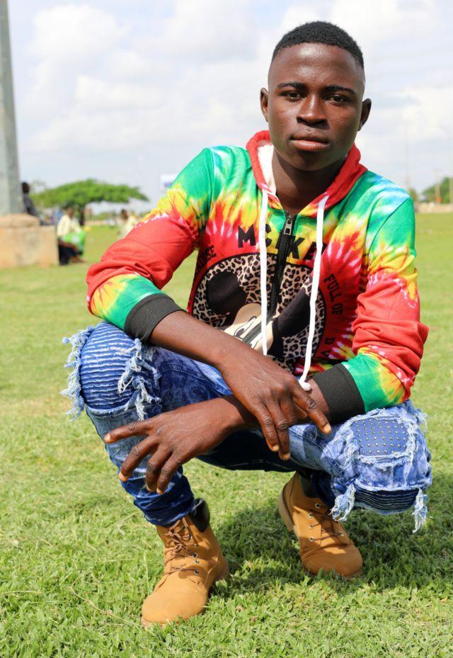 A boy in colourful shirt
