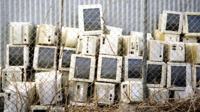 A lot of computers in a garbage can