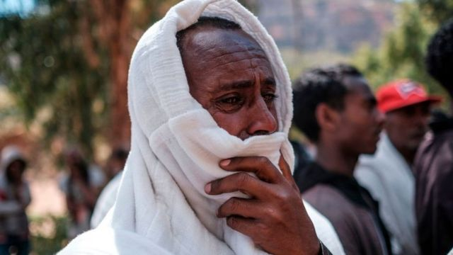 A man mourns in the village of Dengolat, North of Mekele, the capital of Tigray