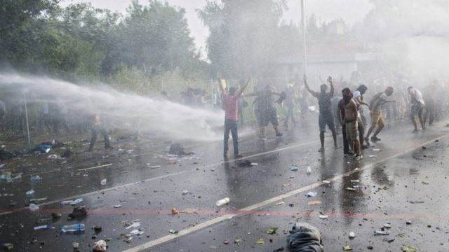 Hungarian police use water cannon at the border between Serbia and Hungary near Horgos, northern Serbia, 16 September 2015