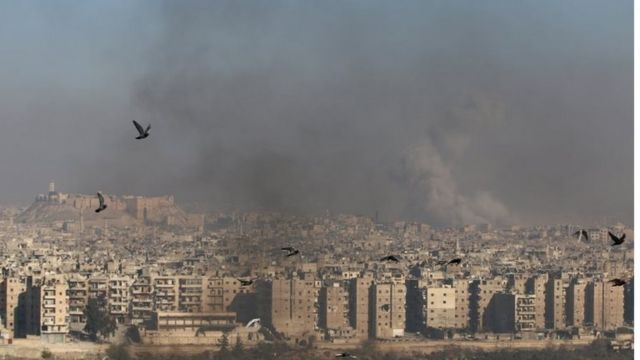 Smoke rises from a rebel-held area of Aleppo, Syria on 9 December 2016