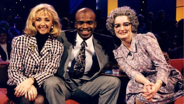 Debbie McGee, Kriss Akabusi and Caroline Aherne as Mrs Merton