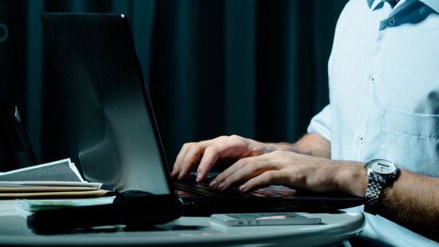 A generic image of a person's hands on a computer keyboard
