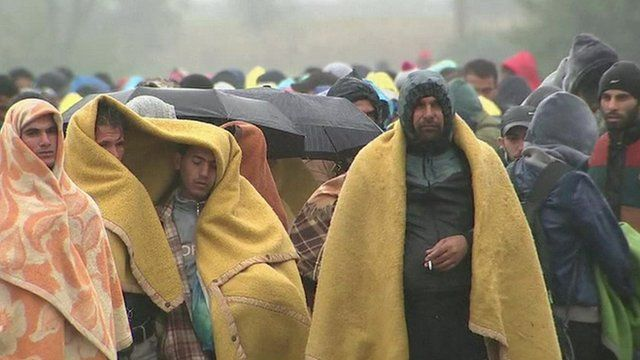 Migrants wrapped in blankets