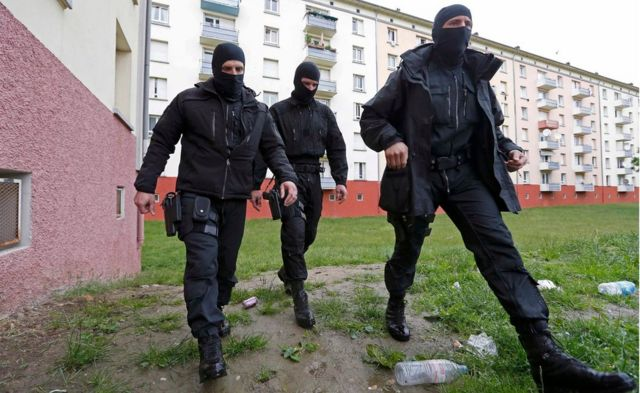 File picture shows French special Police forces as they patrol a residential building area in the Meinau suburb of Strasbourg, May 13. 2014.