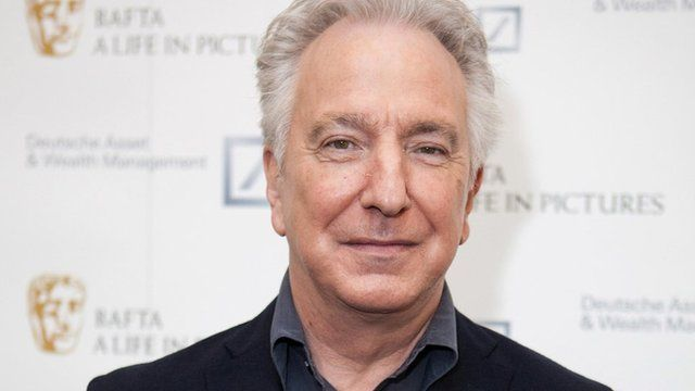 """Actor Alan Rickman poses for photographers on arrival at """"BAFTA A Life In Pictures, with Alan Rickman"""" in central London, April 15, 2015."""