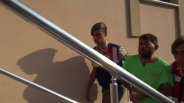 Turkish security forces escorting Captain Mustafa Serdar Ozay into police station (1 August 2016)