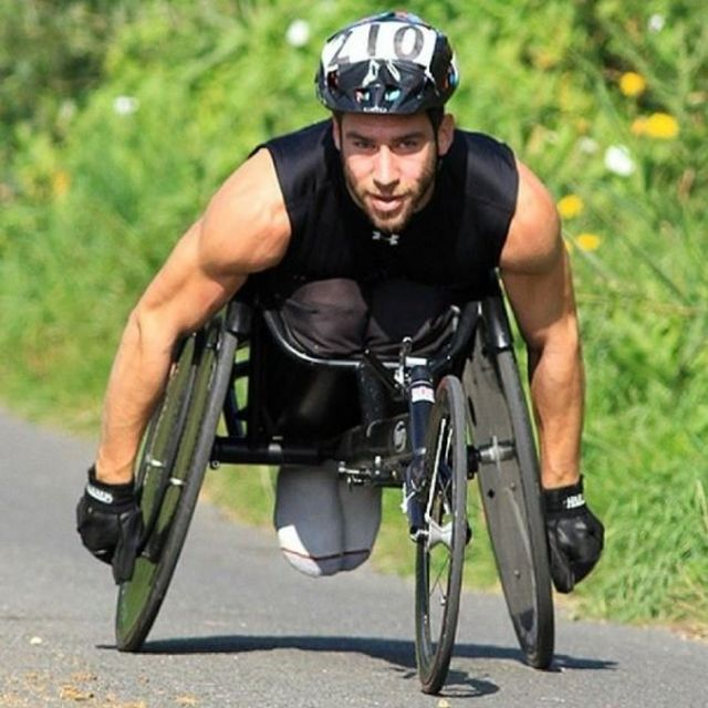 Paraplegic man drags himself through airport