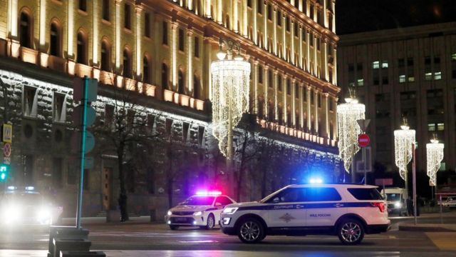 Police vehicles block a street near the Federal Security Service (FSB) building after a shooting incident in Moscow, 19 December 2019