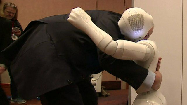 Rory Cellan-Jones hugging a robot