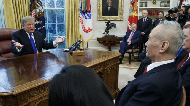 "US President Donald J. Trump (L) talks with Vice Premier of the People""s Republic of China Liu He (R) during a meeting in the Oval Office of the White House in Washington, DC, USA, 22 January 2019."