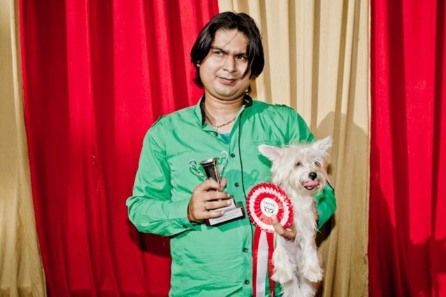 ल्हासा एप्सो अपने कुत्ते के साथ