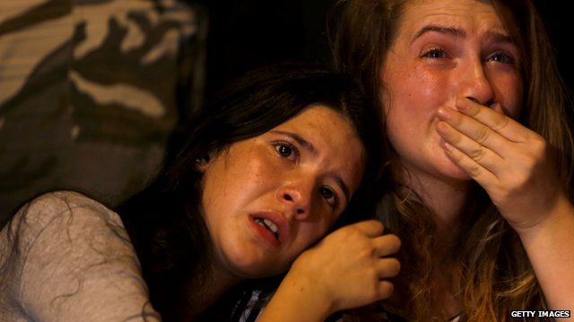 Two teenage girls in Jerusalem crying as they mourn girl stabbed to death at a Gay Pride march last week