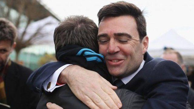 Andy Burnham hugs man following verdicts