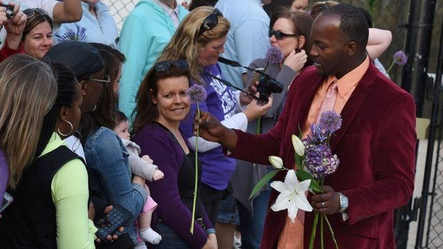 Man handing out flowers