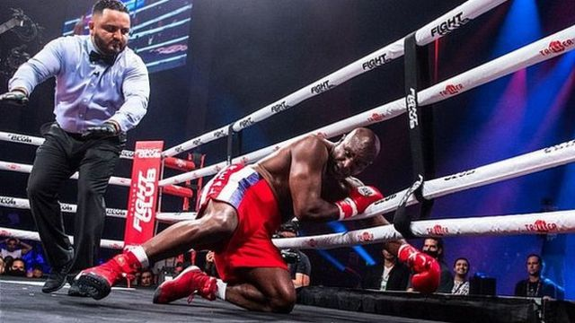 Evander Holyfield is knocked down by Vitor Belfort during the first round of the fight during Evander Holyfield vs. Vitor Belfort presented by Triller at Seminole Hard Rock Hotel & Casino on September 11, 2021 in Hollywood, Florida.
