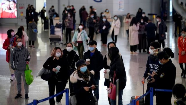 Passengers wearing masks at the Pudong International Airport in Shanghai