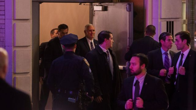 """Vice President-elect Mike Pence, top centre, leaves the Richard Rodgers Theatre after a performance of """"Hamilton,"""" in New York, Friday, Nov. 18, 2016."""