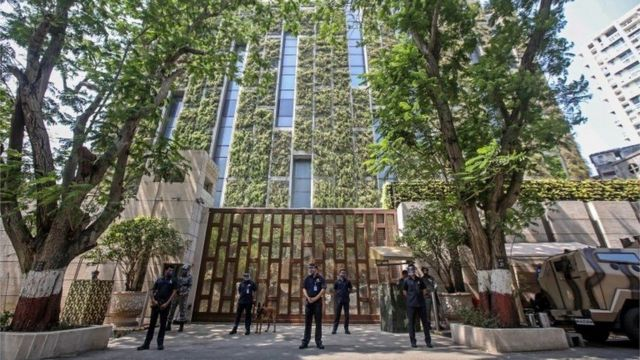 Policemen in front of the 27-story residence of Mukesh Ambani