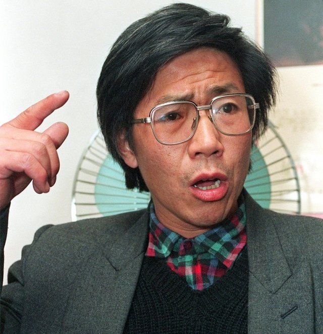 Chinese dissident Qin Yongmin gestures during a press conference in Beijing on 17 November, 1993