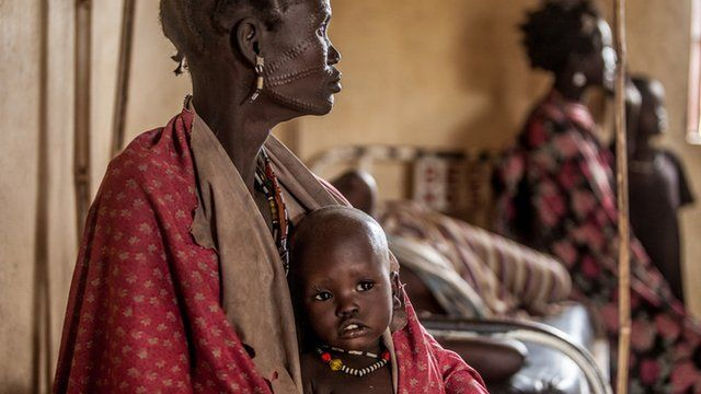 One year-old Hakaroom sits with her mother Lokuru at a Save the Children supported health centre in Kapoeta, South Sudan, after being treated for severe pneumonia