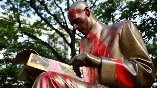 Statue of famous Italian journalist and writer, Indro Montanelli, is seen smeared with red paint during the protests against racism, in Milan, Italy - 14 June 2020
