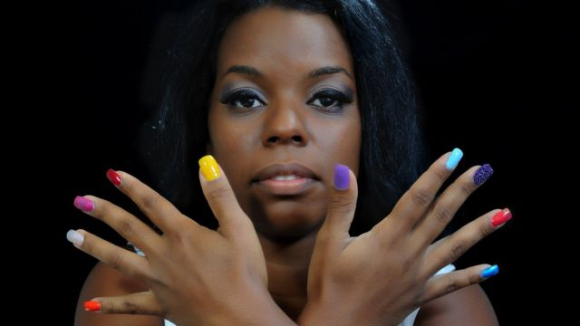 A woman with painted nails