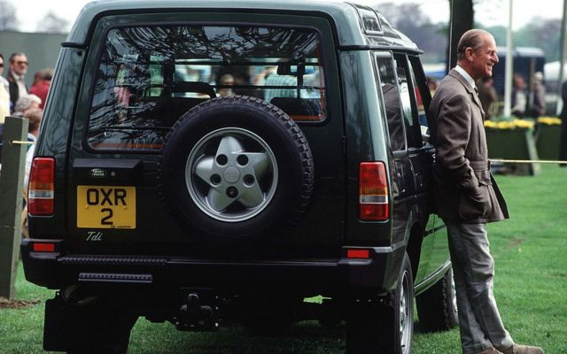 Prince Philip with a Land Rover Discovery in 1991.