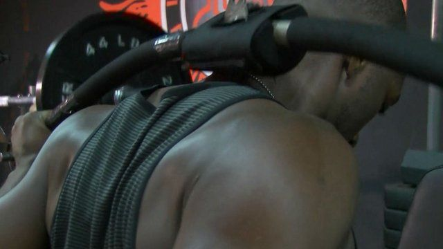 Man working out in a Nigerian gym