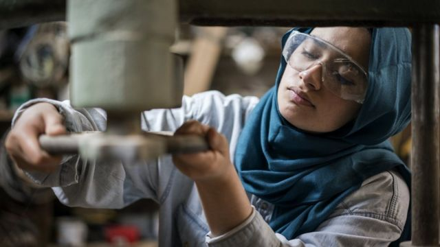 A woman doing factory work