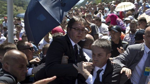 "Aleksandar Vucic, Serbia""s prime minister, centre, is seen during a scuffle at the Potocari memorial complex near Srebrenica"