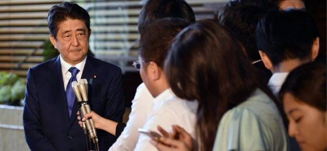Japanese PM Shinzo Abe speaks to reports in Tokyo (15 Sept 2017)