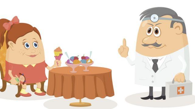 Девочка за столом с мороженым и врач