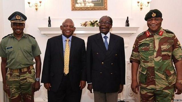 Mr Mugabe (second right) under house arrest, posing alongside Zimbabwe Defence Forces Commander General Constantino Chiwenga (right)