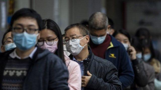 люди в масках в Гуанчжоу