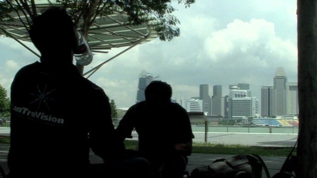 Two men looking at Singapore skyline
