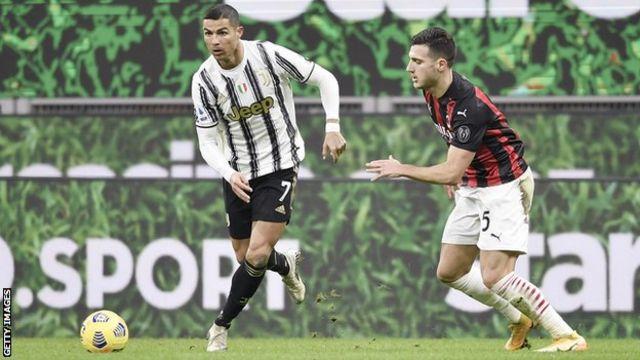 Cristiano Ronaldo (izda) y Diogo Dalot