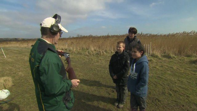 Pupils being shown how to clay pigeon shoot