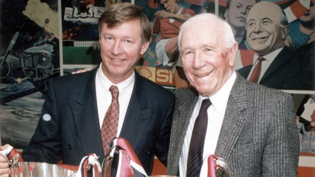 Sir Alex Ferguson and Sir Matt Busby pose together with their respective European trophies in 1991