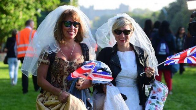 Women wear wedding dresses on the Long Walk
